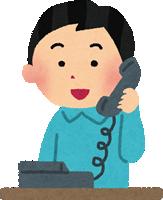 家電・固定電話で話す男性
